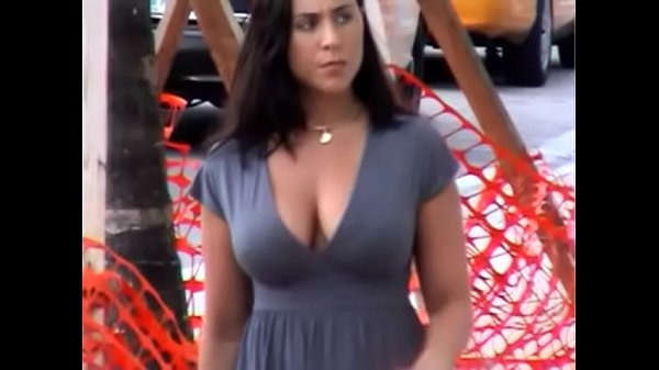 Busty candid American girl walking down the street
